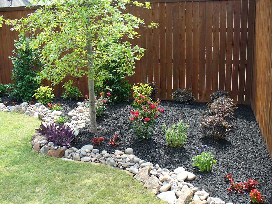 Residential hardscape services empire landscaping for Installing river rock landscaping
