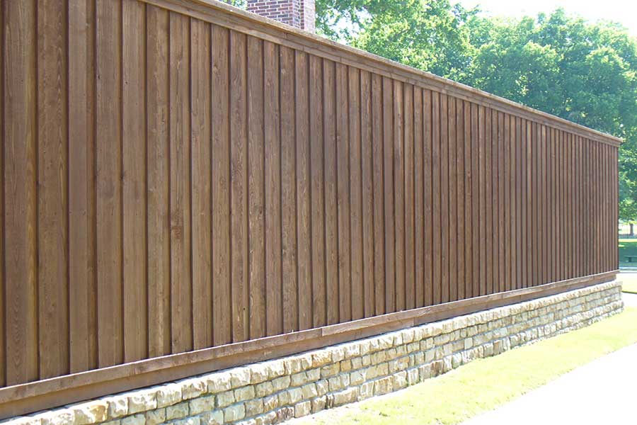 Empire Landscaping Wooden Fence on Retaining Wall